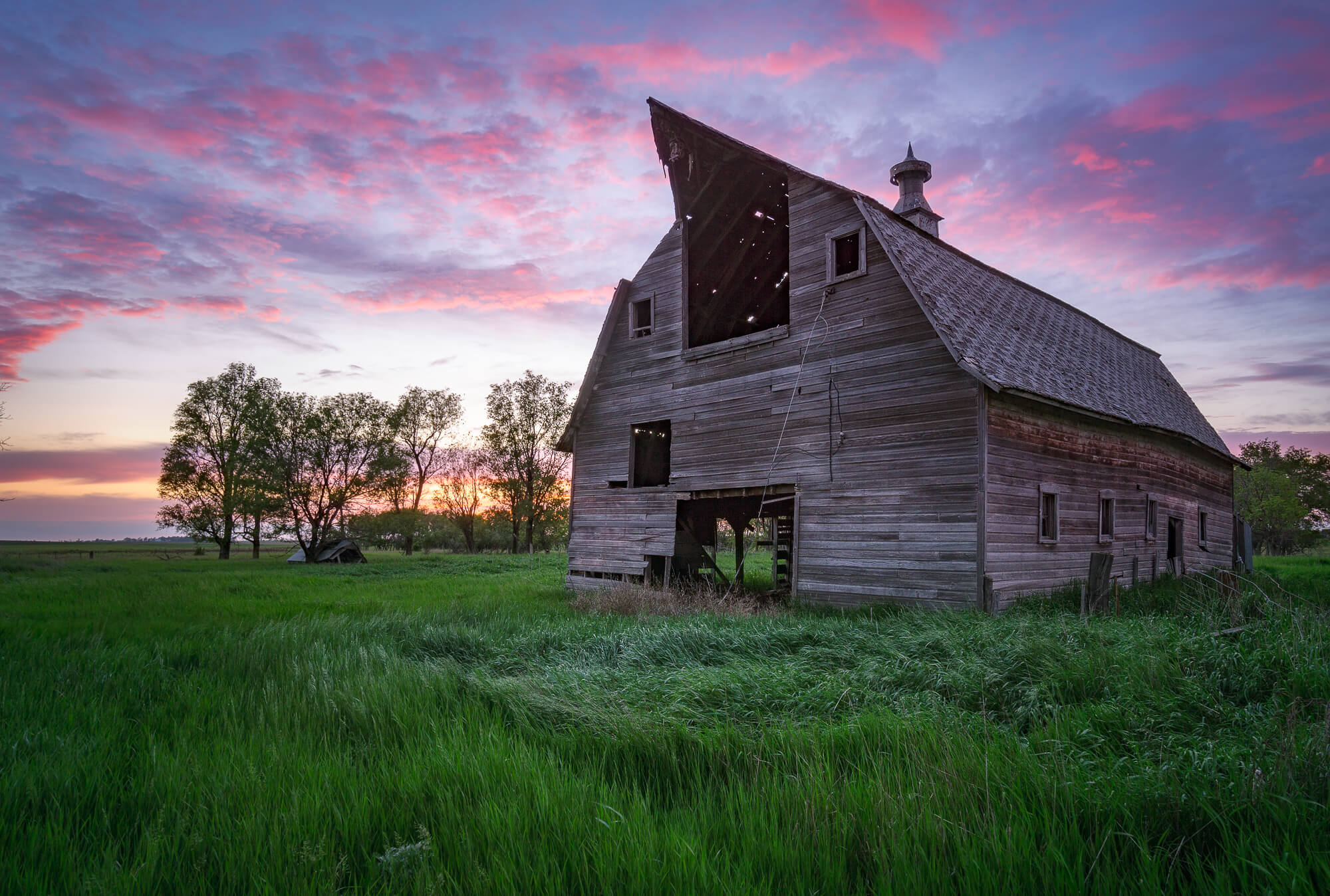 Sunset over an abandoned pole barn