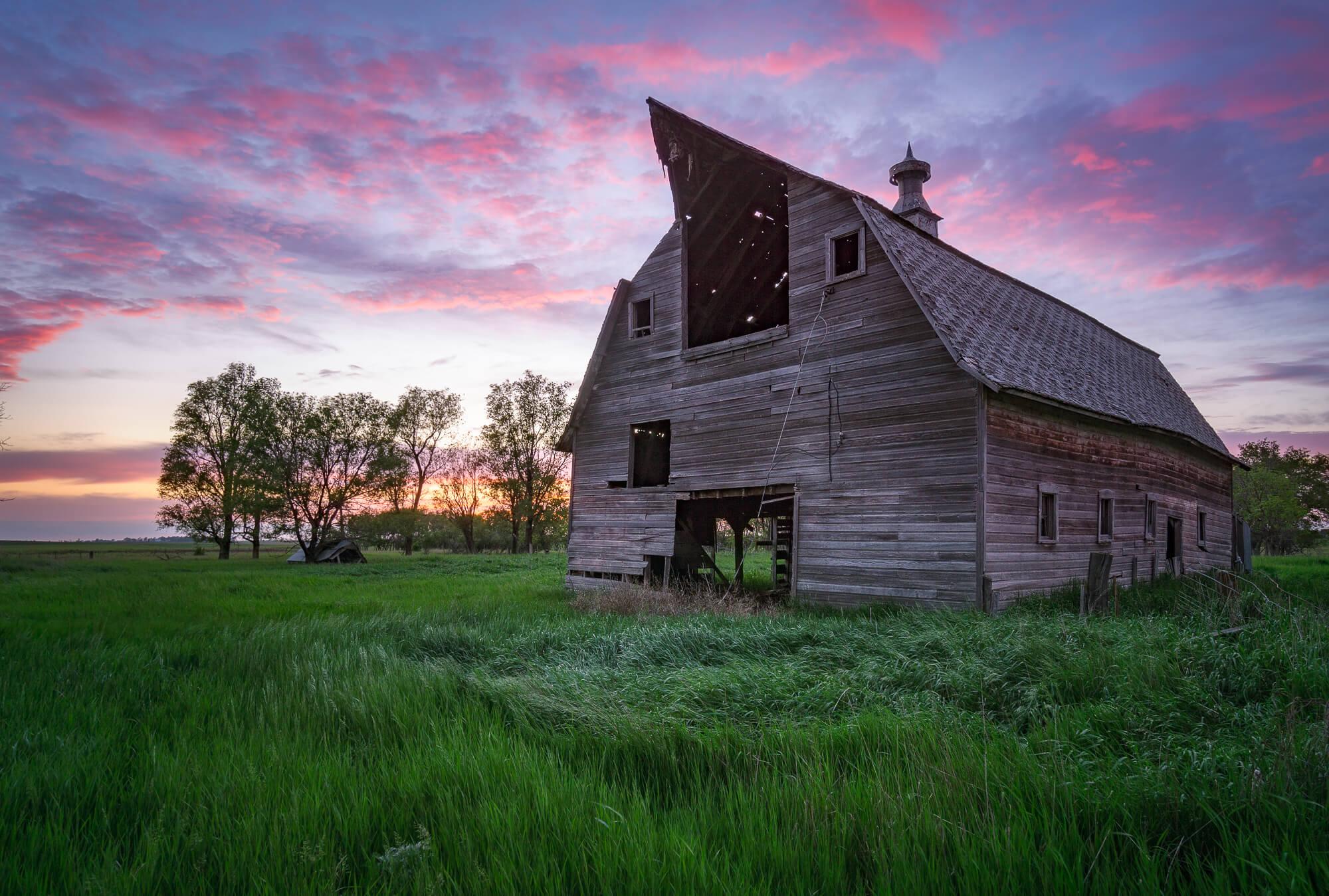 Sunset over an abandoned pole barn
