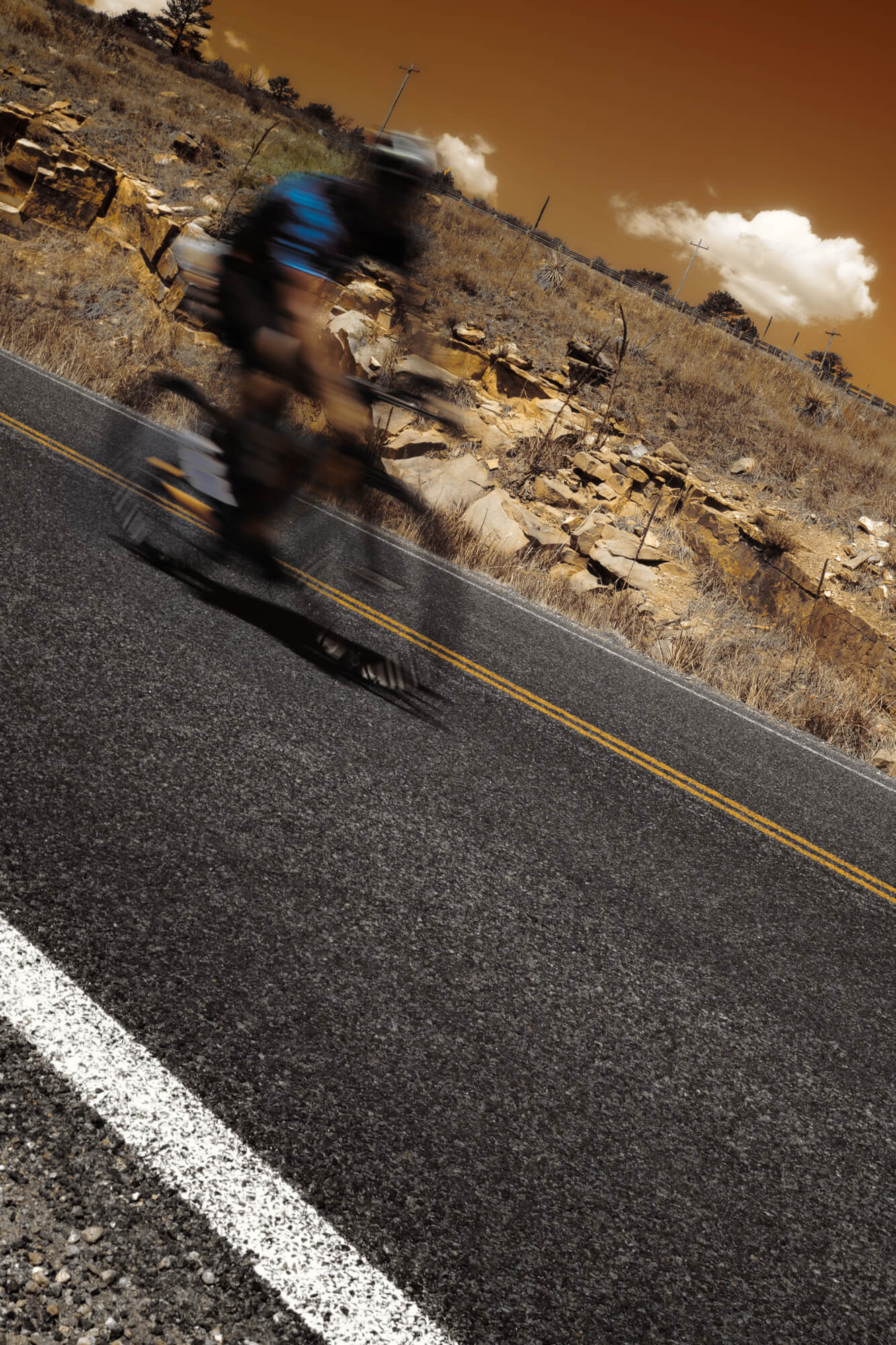 Artistic edit of a cyclist in motion photographed on the Intentionally Lost cycling tour and photography workshop