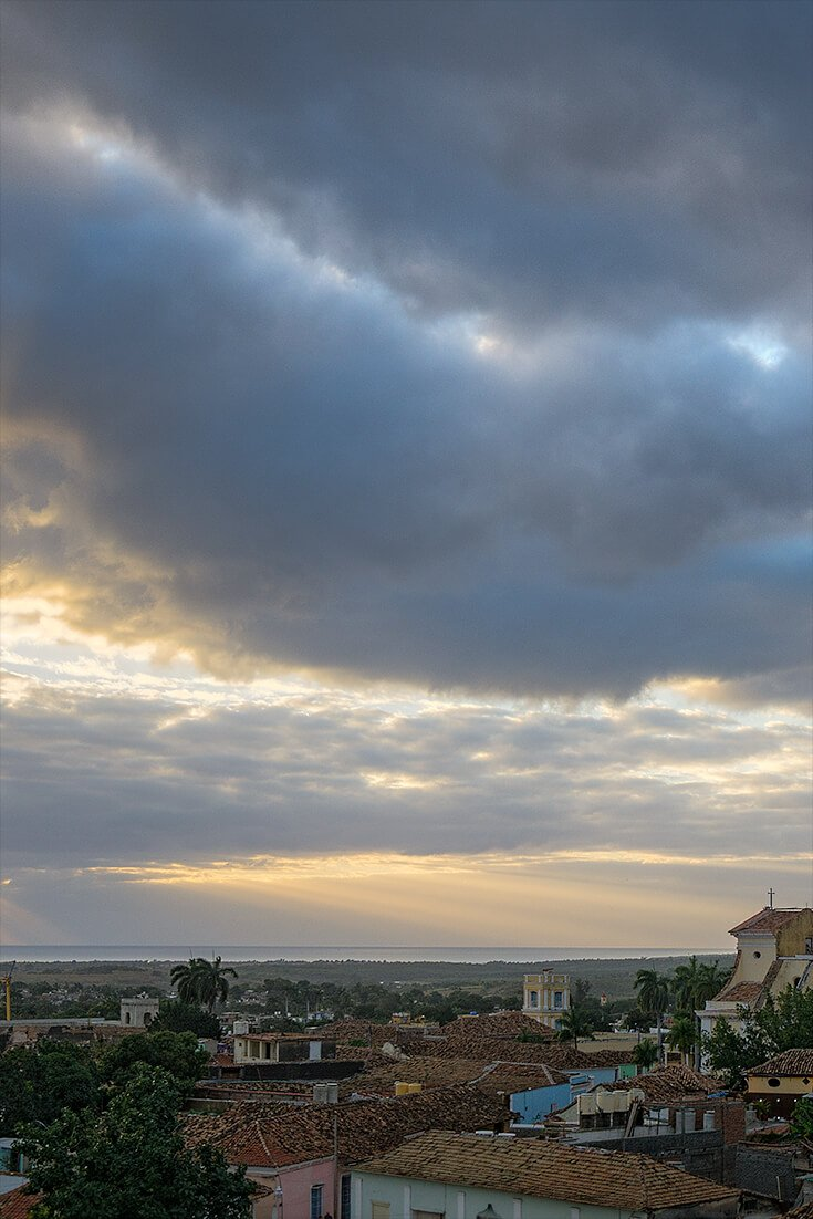 A fortunate moment in Trinidad Cuba when the sun was setting over the ocean and God rays broke out through the clouds over the Caribbean.  Beautiful sunsets can be found anywhere in the world if you know what to look for. 